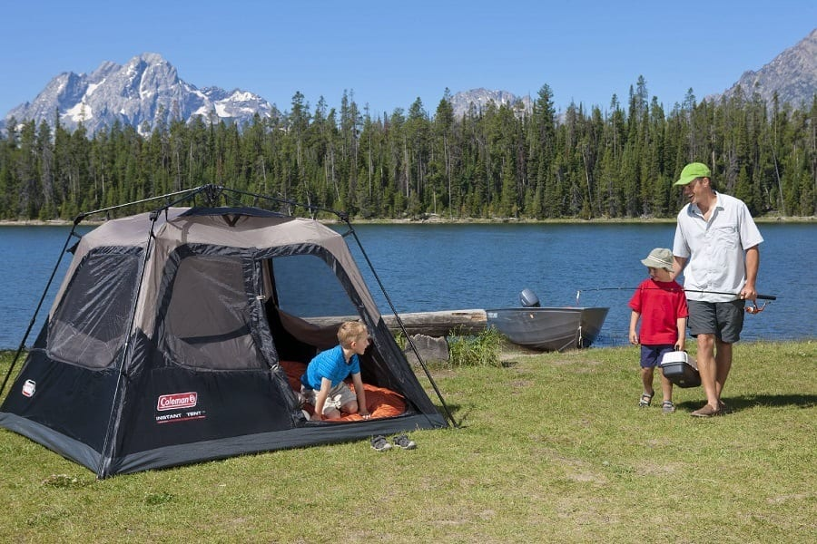 Little Boy in Coleman Instant Cabin Tent While Dad And Brother Going on Fishing